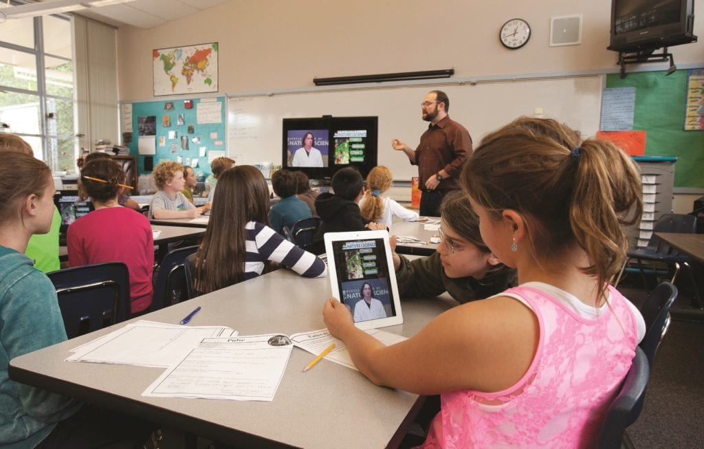 Elementary students distance learning in classroom