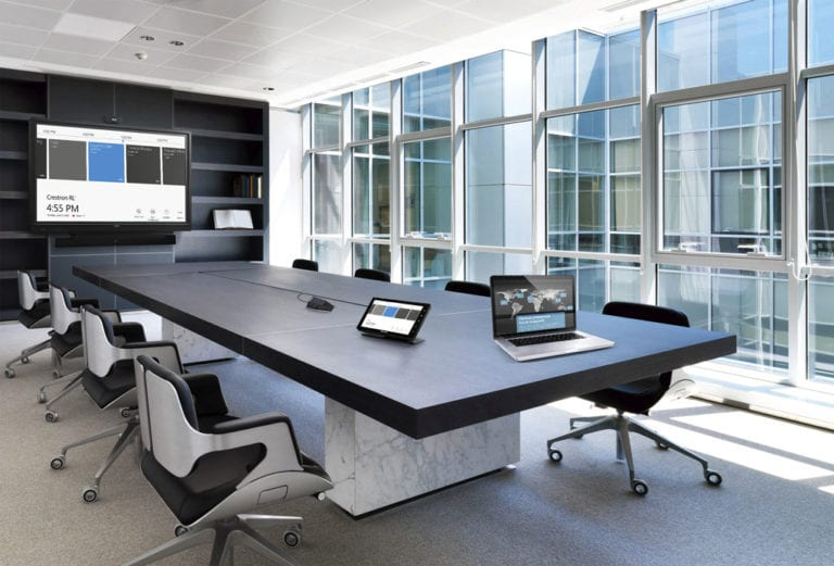 Boardroom with windows and Crestron controls.