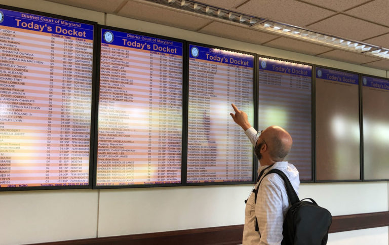 Digital signage displaying court docket and room number information