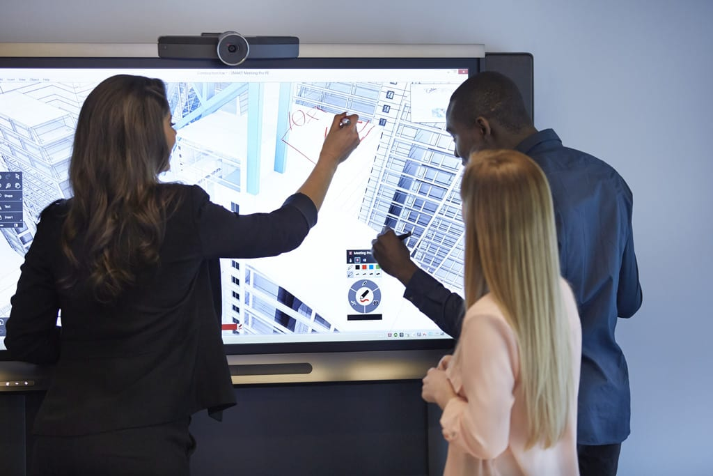 Millennials using a SMART Technology interactive whiteboard