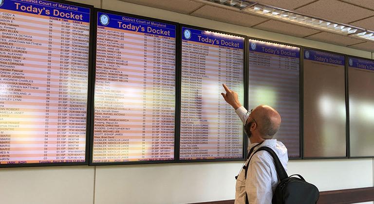 Digital signage displaying court docket and room number information